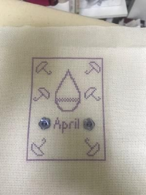 I got April stitched. I will wait and fully attach the little buttons when I go to FFO it. I made a few changes. It was a quick and fun stitch, I used DMC 210 and white 18count Aida