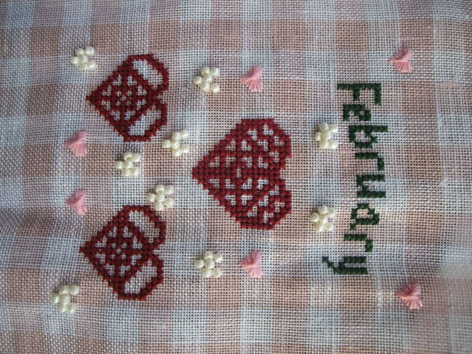 It is cold and icy here so what else to do but stitch . February is done . It took me a while to settle on fabric and then I changed colours .after that I decided I did not like the white floss hearts and went for beads. . I may still add the cross stitch border , but so far I think I like it aas is.