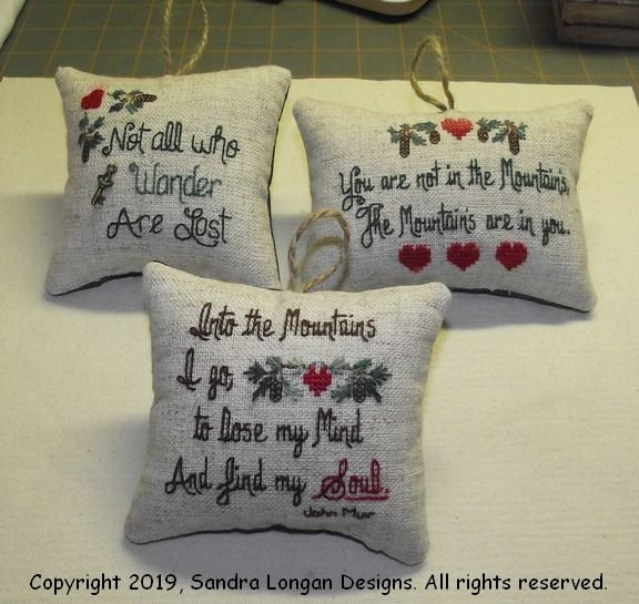 These are going to hang in our 2002 Keystone Laredo 5th wheel. These are my original designs using John Muir quotes. Mini pillow finishes on 28 count.