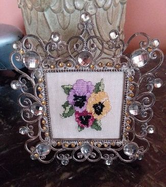 Pansy freebie from Janlynn website.  I used beads in the middle instead of floss.