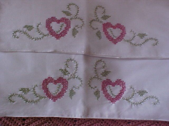 Pillow cases embroidered to gift a friend.<br />Cotton stitched with DMC floss.