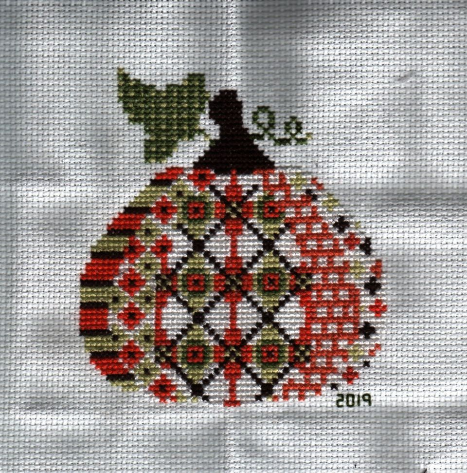 """Creative Needle Arts """"Patterned Pumpkin #1A kit that took me a week to stitchGot frame for it this last weekend"""