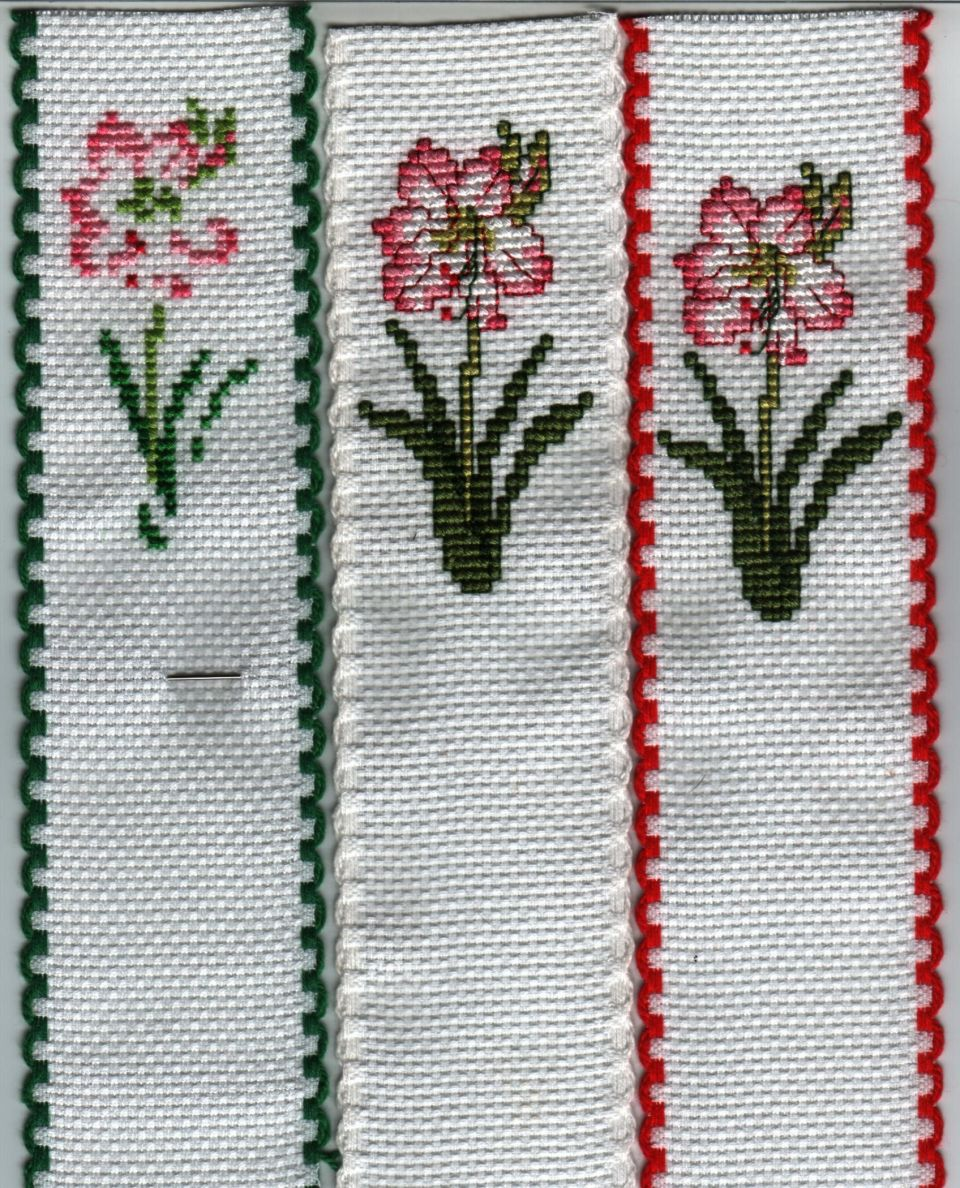 Been wanting to stitch this Amaryllis for Christmas ornies for awhile...but never found right frame for them...well looks nice on Ribband for Bible marker:)....not sure how many I will be making